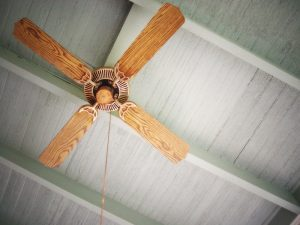wooden ceiling fan on grey ceiling