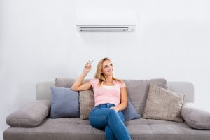 woman-operating-heat-pump
